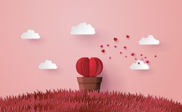 Origami made Heart shape tree with pot set in the pink grass. Royalty Free Stock Photos