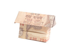 Origami Made of Indian rupee banknotes. Isolated on white background Stock Photo