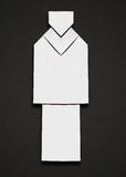 Origami man. White origami man in a suite on a black background Stock Photography