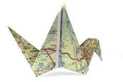 Origami. With a map. Symbol of traveling Royalty Free Stock Image