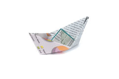 Origami newspaper ship. Close up origami newspaper ship isolated on white background Stock Image