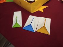 Origami. Shaped fish, colored pencil, flower Royalty Free Stock Images