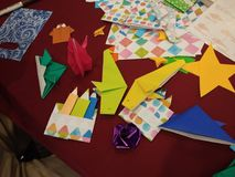 Origami. Shaped fish, colored pencil, flower Stock Images