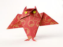 Origami owl isolated on white. Made of red paper with two cute yellow eyes Royalty Free Stock Photo