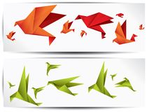 Origami paper bird on abstract background Stock Photos
