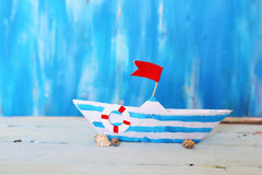 Origami paper boat. Photo of cute origami paper boat on wooden background stock photos