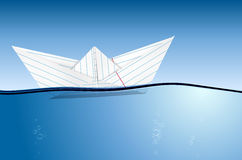 Origami paper boat on water level Royalty Free Stock Images