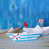 Origami paper boats Stock Images