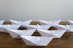 Origami paper boats on a wooden table Stock Photography