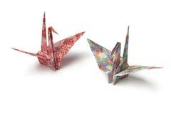 Origami paper crane birds. Two origami paper crane birds on white background stock photo