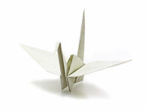 Origami paper crane made of recycle paper. On white Stock Photography