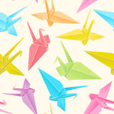 Origami paper cranes. Seamless Pattern of a Japanese crane out of colored paper Royalty Free Stock Image