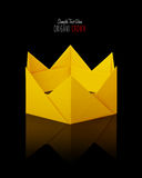 Origami paper crown. Origami paper yellow gold king crown irony on a black background Stock Photo