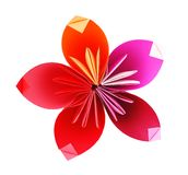 Origami paper flower. In pink, red and orange. Isolated on white stock photo