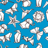 Origami paper folded figures seamless pattern. Origami white paper folded figures on blue background souvenirs presents wrap paper seamless pattern abstract Stock Photos