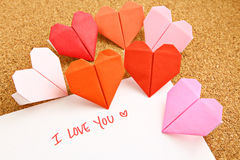 Origami paper hearts. With message Stock Image