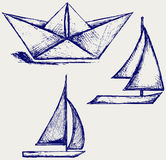 Origami paper ship and sailboat sailing Royalty Free Stock Photography
