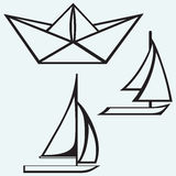 Origami paper ship and sailboat sailing Royalty Free Stock Photos