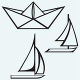 Origami paper ship and sailboat sailing Royalty Free Stock Photos