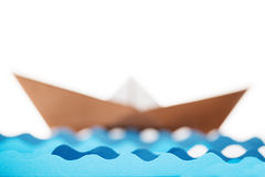 Origami paper ship and water waves on white background Stock Images