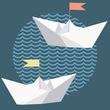 Origami paper ships with flags. Origami paper ships and blue waves Stock Image