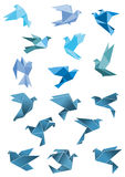 Origami paper stylized blue flying birds Royalty Free Stock Images