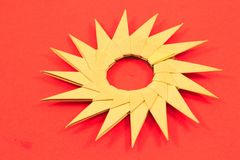 Origami paper sun isolated on red background Royalty Free Stock Image