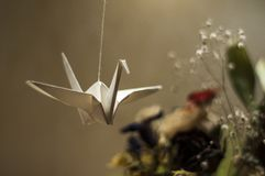 Origami. Paper Swan Hanging on a thread. Toys from paper. stock photos