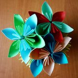 Origami: a paper vase with flowers stock photography