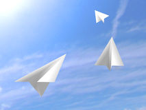 Origami paper white airplanes flying on the sky. 3d Stock Photography