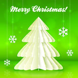 Origami paper white vector Christmas tree. On green background Stock Image