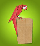 Origami parrot made of paper Royalty Free Stock Photo