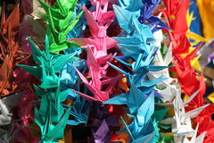 Origami Peace Cranes. Dozens of hanging origami peace cranes in a tapestry of colors. They are symbols of peace. Each years millions of the cranes are sent to royalty free stock photos