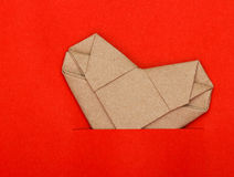 Origami recycle paper heart on red paper Royalty Free Stock Photography