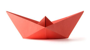 Origami red boat. Paper origami red boat on the white background stock photography