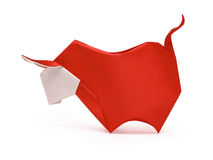 Origami red bull. Origami red horned furious bull on a white background Stock Photography