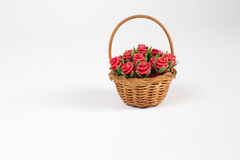 Origami rose. Red origami roses with straw in a basket Stock Photos