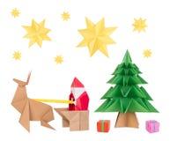 Origami Santa Claus, hjortar, julgran och stjärnor Arkivfoton