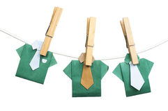 Origami shirts on rope Stock Photo