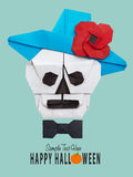 Origami skull in hat Stock Images