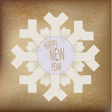 Origami snowflake with happy new year text Royalty Free Stock Photo
