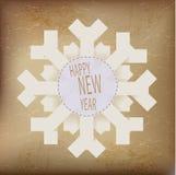 Origami snowflake med lycklig text för nytt år Royaltyfri Foto
