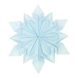 Origami snowflake. Origami paper fragility christmas winter cold blue snowflake on a white background Royalty Free Stock Image