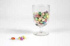 Origami star. Colourful origami stars in a glass royalty free stock photos