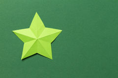 Origami star. Paper origami star laying on colorful background Royalty Free Stock Photography