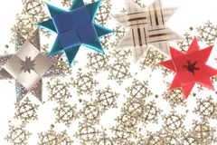 Origami star postcard on the snowflake garland Stock Photography