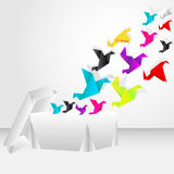 Origami start to fly from a box Stock Photo