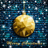 Origami style gold Christmas toy with shadow on illuminated blue brick wall background with snow Royalty Free Stock Photos