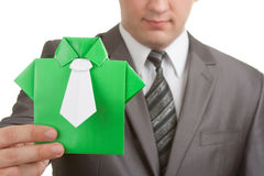 Origami suit in hands Royalty Free Stock Photography