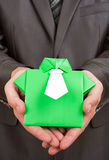 Origami suit in hands Royalty Free Stock Image